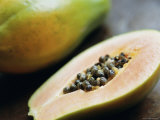 Papaya (Pawpaw) Sliced Open to Show Black Seeds Photographic Print by Lee Frost