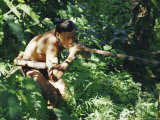 Punan Man Using a Blow-Pipe, Lasam, Borneo, Asia Photographic Print by Claire Leimbach