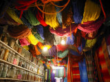 Brightly Dyed Wool Hanging from Roof of a Shop, Marrakech, Morrocco, North Africa, Africa Fotografisk tryk af John Miller