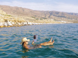 Woman Floating in the Dead Sea Reading a Magazine, Aqaba, Jordan Photographic Print by Alison Wright