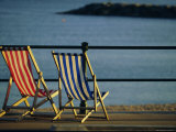 Two Deckchairs on the Seafront, Sidmouth, Devon, England, UK, Europe Photographic Print by John Miller