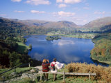 Couple Resting on Bench, Viewing the Lake at Grasmere, Lake District, Cumbria, England, UK Photographic Print by Nigel Francis