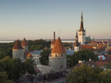 Medieval Town Walls and Spire of St. Olavs Church at Dusk, Tallinn, Estonia, Baltic States, Europe Photographic Print by Neale Clarke