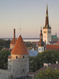 Medieval Town Walls and Spire of St. Olav&#39;s Church at Dusk, Tallinn, Estonia, Baltic States Photographic Print by Neale Clarke