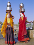 Two Women by a Well Carrying Water Pots, Barmer, Rajasthan, India Photographic Print by Bruno Morandi