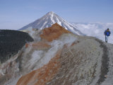 Koryaksky Volcano Seen Beyond Walkers on Crater Rim of Avacha Volcano, Russia Photographic Print by Anthony Waltham