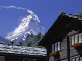 The Peak of the Matterhorn Mountain Towering Above Chalet Rooftops, Swiss Alps, Switzerland Photographic Print by Ruth Tomlinson