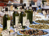 Olives and Olive Oil on Sale at a Market, Provence-Alpes-Cote-D'Azur, France Photographic Print by Ruth Tomlinson