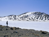 Hiker on Tongariro Crossing Trek by Blue Lake Under Winter Ice and Snow, North Island, New Zealand Photographic Print by Anthony Waltham
