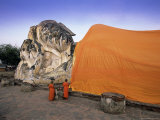 Two Novice Buddhist Monks in Front of a Statue of the Reclining Buddha, Central Thailand, Thailand Photographic Print by Gavin Hellier