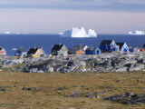 Painted Village Houses in Front of Icebergs in Disko Bay, West Coast, Greenland Photographic Print by Anthony Waltham