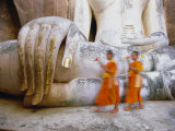Novice Monks and Phra Atchana Buddha Statue, Wat Si Chum, Sukhothai, Sukhothai Province, Thailand Photographic Print by Gavin Hellier