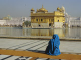 A Pilgrim in Blue Sits by the Holy Pool of Nectar at the Golden Temple, Punjab, India Photographic Print by Jeremy Bright