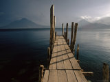 Wooden Jetty and Volcanoes in the Distance, Lago Atitlan (Lake Atitlan), Guatemala, Central America Photographic Print by Colin Brynn