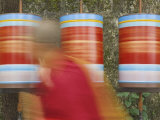Buddhist Monk Passing Prayer Wheels, Mcleod Ganj, Dharamsala, Himachal Pradesh State, India, Asia Photographic Print by Jochen Schlenker