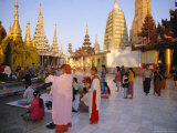 Buddhist Worshippers at the Shwedagon Paya (Shwe Dagon Pagoda), Yangon (Rangoon), Myanmar (Burma) Photographic Print by Christina Gascoigne