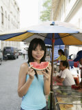 Thai Woman with a Slice of Water Melon, Bangkok,Thailand, Southeast Asia, Asia Photographic Print by Angelo Cavalli