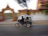 Tuk Tuk Racing Through Vientiane, Laos, Indochina, Southeast Asia, Asia Photographic Print by Andrew Mcconnell