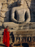 Monk in Front of the Seated Buddha Statue, Gol Vihara, Polonnaruwa, Sri Lanka, Asia Photographic Print by Bruno Morandi
