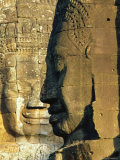 Stone Heads Typifying Cambodia on the Bayon Temple at Angkor Wat, Siem Reap, Cambodia, Asia. Photographic Print by Bruno Morandi