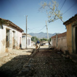Street Scene with Man on Horseback, Trinidad, Cuba, West Indies, Central America Photographic Print by Lee Frost