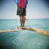 Man Standing on Outrigger in Indian Ocean, Zanzibar, Tanzania, East Africa, Africa Photographic Print by Lee Frost