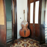 Double Bass Propped Against a Wall, Cienfuegos, Cuba, West Indies, Central America Photographic Print by Lee Frost