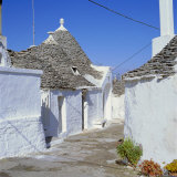 Alberobello, Typical Trulli Houses, Puglia (Apulia), Italy Photographic Print by Tony Gervis