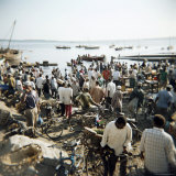 People Waiting on Beach for Dhows to Land Fish, Stone Town, Zanzibar, Tanzania, East Africa, Africa Photographic Print by Lee Frost