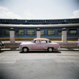 Old Pink American Car Outside Railway Station, Havana, Cuba, West Indies, Central America Photographic Print by Lee Frost
