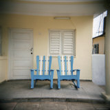 Blue and White Chairs Against a Yellow Wall, Vinales, Cuba, West Indies, Central America Photographic Print by Lee Frost