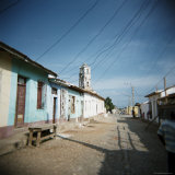 Street Scene with Old Church in Distance, Trinidad, Cuba, West Indies, Central America Photographic Print by Lee Frost