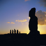 Silhouette of Ahu Tahai in Foreground and Behind the Five Moai of Ahu Vai Uri, Easter Island Photographic Print by Geoff Renner