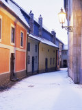 Snow Covered 16th Century Cottages on Golden Lane in Winter Twilight, Hradcany, Czech Republic Photographic Print by Richard Nebesky