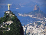 Statue of Christ the Redeemer Overlooking City and Sugar Loaf Mountain, South America Photographic Print by Marco Simoni