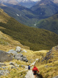 A Hiker on a Trail Leading to Conical Hill on the Routeburn Track, New Zealand, Pacific Photographic Print by Chris Kober