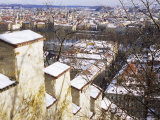 View of City from Snow Covered Gothic Hunger Wall on Petrin Hill, Czech Republic, Europe Photographic Print by Richard Nebesky