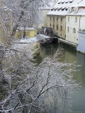 Snow-Covered Certovka Canal and Water Wheel at Kampa Island, Czech Republic, Europe Photographic Print by Richard Nebesky