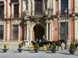 Horse and Carriage with Archbishops Palace in Background in Santa Cruz District, Seville, Spain Photographic Print by Robert Harding