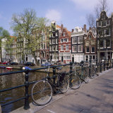 Bicycles on a Bridge Across the Canal at Herengracht in Amsterdam, Holland Photographic Print by Roy Rainford