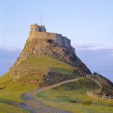 Lindisfarne Slot, Holy Island, Northumberland, England Fotografisk tryk af Roy Rainford