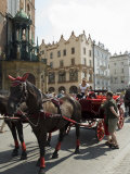 Horse and Carriages in Main Market Square, Old Town District, Unesco World Heritage Site, Poland Photographic Print by Robert Harding