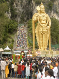 Statue of Hindu Deity with Pilgrims Walking 272 Steps up to Batu Caves, Selangor, Malaysia Photographic Print by Richard Nebesky