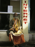 Sadhu Sitting Outside an Internet Cafe, Varanasi, Uttar Pradesh State, India Photographic Print by James Gritz