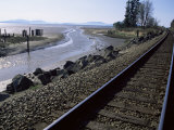 Train Tracks Leading to Bellingham, with San Juan Islands in Distance, Washington State Photographic Print by Aaron McCoy