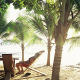 Young Woman Relaxes on Avellans Beach, Costa Rica, Central America Photographic Print by Aaron McCoy