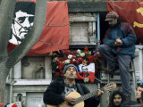 Guitarist Plays Victor Jara Songs at His Grave on 11th De Septiembre, Chile, South America Photographic Print by Aaron McCoy