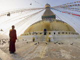 Young Buddhist Monk Turns to Look at the Dome of Boudha Tibetan Stupa in Kathmandu, Asia Photographic Print by Don Smith