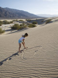 Woman Drawing a Heart in the Sand, Sand Dunes Point, Death Valley National Park, California, USA Photographic Print by Angelo Cavalli