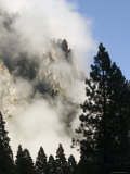 Cloud and Tree Silhouette Surrounding Upper Yosemite Falls, California Photographic Print by Rich Reid